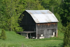 Barn with silver tin roof Stock Photo