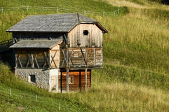 The barn on a slope. The barn on the hillside Stock Photo