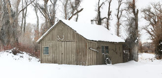 Barn in the snow. Old brown barn in the winter snow Royalty Free Stock Photos
