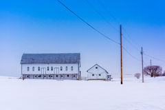 Barn in a snow covered farm field in rural York County, Pennsylv Royalty Free Stock Images