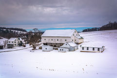Barn in a snow covered farm field in rural York County, Pennsylv Royalty Free Stock Photos