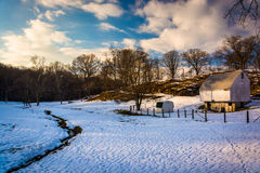 Barn and snow-covered field in rural Baltimore County, Maryland. Royalty Free Stock Photos
