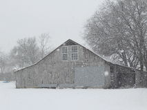 Barn in the snow. Very peaceful winter day a the old farm great for a rustic designed room Royalty Free Stock Images