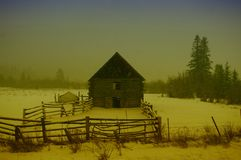 Barn in a snowstorm. Stock Photography