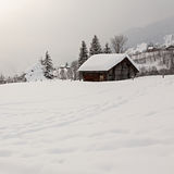 Barn on Snowy Field. Old barn on snowy field in the Swiss Alps. Grindelwald, Switzerland royalty free stock photos