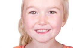 Barn som close ler upp royaltyfria bilder