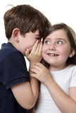 Barn som delar en hemlighet Royaltyfria Bilder