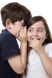 Barn som delar en hemlighet Fotografering för Bildbyråer