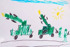 Barn som drar krigmaskiner och soldater Royaltyfria Bilder