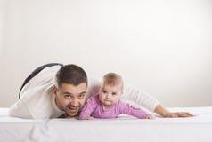 Fader med barnet Arkivbild