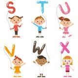 Barn som har ballongen av, alfabet Arkivfoton