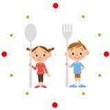 Barn som har en sked och en gaffel Arkivfoton