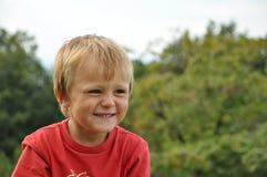 barn som little skrattar Fotografering för Bildbyråer