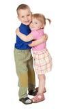 barn som älskar två Arkivbild