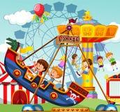 Barn som rider på ritter på funfairen royaltyfri illustrationer