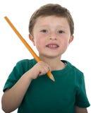 barn som rymmer den schoolage litet barn för stor blyertspenna Arkivbild