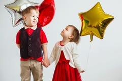 Barn som rymmer en stjärna formad, sväller Royaltyfria Foton