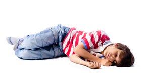 Barn som sover, på vit bakgrund Fotografering för Bildbyråer