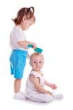 Barn som spelar med hårkammen Royaltyfri Foto