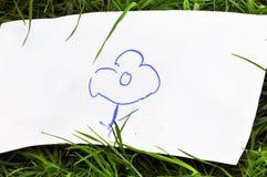 barn som tecknar blomma s arkivfoton