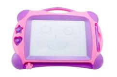 barn som tecknar den magnetiska s-tableten royaltyfri foto