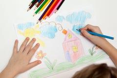barn som tecknar s royaltyfri bild