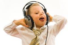 barn som tycker om musik Royaltyfri Bild