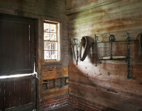 Barn Stall. Empty barn stall with tools hanging on the wall Stock Image