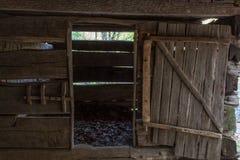 Barn stall in a vintage rough hewn log barn. Horizontal aspect Royalty Free Stock Photos