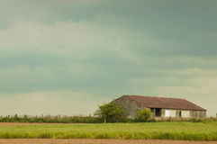 Barn in storm. Barn in open countryside with approaching storm Stock Photos