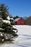 Barn style home in snow. A New England barn inspired house on acres of snowy land Stock Images
