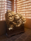 Barn with the sun  from outside and straw and hay Stock Photos
