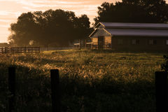 Barn at sunrise stock photos
