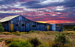 Barn at Sunset. Big old barn in a field at sunset Royalty Free Stock Photography