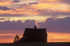 Barn at sunset in silhouette, Davenport, WA Stock Photos