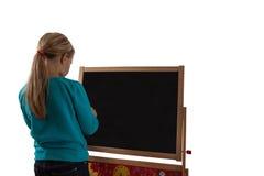 Barn - svart tavla med barnet - klippta outs Arkivbild