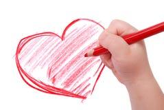 barn tecknar handhjärtablyertspennan arkivfoton