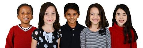 Barn tillsammans på vit bakgrund Arkivfoto