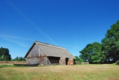 Barn under blue sky. A barn under a blue sky in a field. This is in Kluki, Poland Stock Images