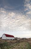 Barn Under a Cloudy Sky Stock Images