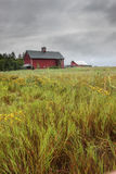 Barn under a cloudy sky. Royalty Free Stock Images
