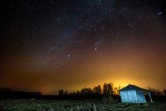 Barn under starry sky at night Stock Image