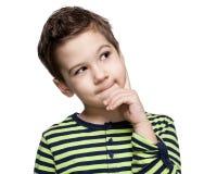 Barn uttryck gullig pojke little som tänker arkivfoto