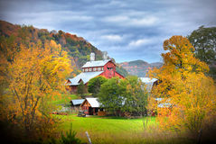 Barn in Vermont country side. Surrounded by autumn trees Royalty Free Stock Images