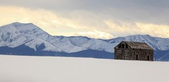 Barn with a View - Landscape. Winter view of an old ruined barn with the Bridger Mountains in the background Montana Royalty Free Stock Photo
