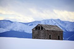Barn with a View. Winter view of an old ruined barn with the Bridger Mountains in the background Montana Stock Photography