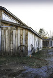 Barn And Wagon Wheels Stock Photography