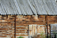 Barn Wall of Logs. Barn wall shows notched logs on old pole barn.  Closeup of wall and entry Royalty Free Stock Image