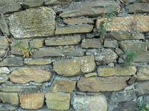 Barn stone wall of the house Stock Images