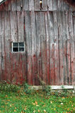 Barn wall with a window. An old barn wall with a small window royalty free stock photos